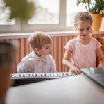 two young musicians playing classic digital piano 8XDB87D 1